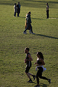 Now in the third week of Corovirus lockdown, a restriction imposed by the UK government during the Coronavirus pandemic, Londoners exercise in spring sunshine and warm temperatures in the early evening in Ruskin Park, a public green space in Lambeth, south London, on 14th April 2020, in London, England.