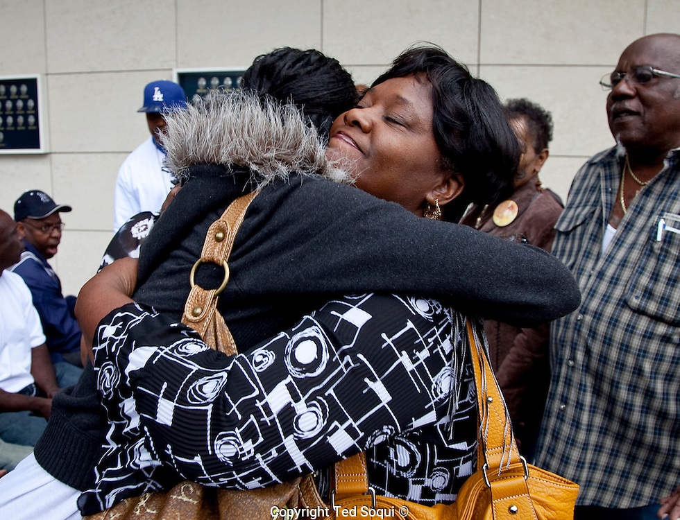 Family of slain &quot;grim Sleeper&quot; suspects hug outside the press conference.<br /> LAPD and city officials hold a press conference to announce the capture of the &quot;Grim Sleeper&quot; serial murder suspect, Lonnie David Franklin jr.<br /> Franklin will be charged with 10 counts of murder, and one count of attempted later today.