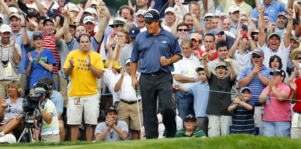 Phil Mickelson of the US pumps his fist after sinking a birdie putt on the sixteenth hole during the third day of the US Open Golf Championship at Winged Foot Golf Club in Mamaroneck, New York Saturday, 17 June 2006. .