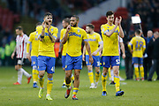 Leeds United midfielder Mateusz Klich (43) Leeds United midfielder Kemar Roofe (7)  and Leeds United defender Aapo Halme (52) applaud the fans at full time during the EFL Sky Bet Championship match between Sheffield United and Leeds United at Bramall Lane, Sheffield, England on 1 December 2018.