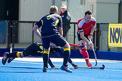 Holcombe's Richard Lane is tackled by Andrew Eversden of Team Bath Buccaneers. Holcombe v Team Bath Buccaneers - Now: Pensions Finals Weekend, Lee Valley Hockey & Tennis Centre, London, UK on 12 April 2015. Photo: Simon Parker