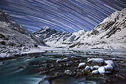 Star Trails over a stunningly clear but cold winter night on the partially frozen Hooker Lake, looking out at New Zealand's highest point, Mount Cook.