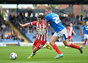 Terry Gornell and Matt Clarke tussle for the ball during the Sky Bet League 2 match between Portsmouth and Accrington Stanley at Fratton Park, Portsmouth, England on 5 September 2015. Photo by Adam Rivers.