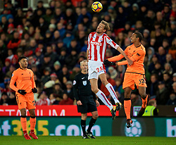 STOKE-ON-TRENT, ENGLAND - Wednesday, November 29, 2017: Stoke City's Peter Crouch and Liverpool's Joel Matip during the FA Premier League match between Stoke City and Liverpool at the Bet365 Stadium. (Pic by David Rawcliffe/Propaganda)