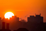 UNITED KINGDOM, London: 27 April 2017 The sun begins to rise amongst tower blocks on a cold day in London this morning. Rick Findler / Story Picture Agency