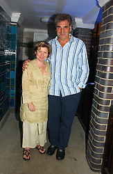 IMELDA STAUNTON and JIM CARTER at a party to celebrate FilmFour becoming the UK's first major free film channel held at Debenham House, Addison Road, London on 20th July 2006.<br />