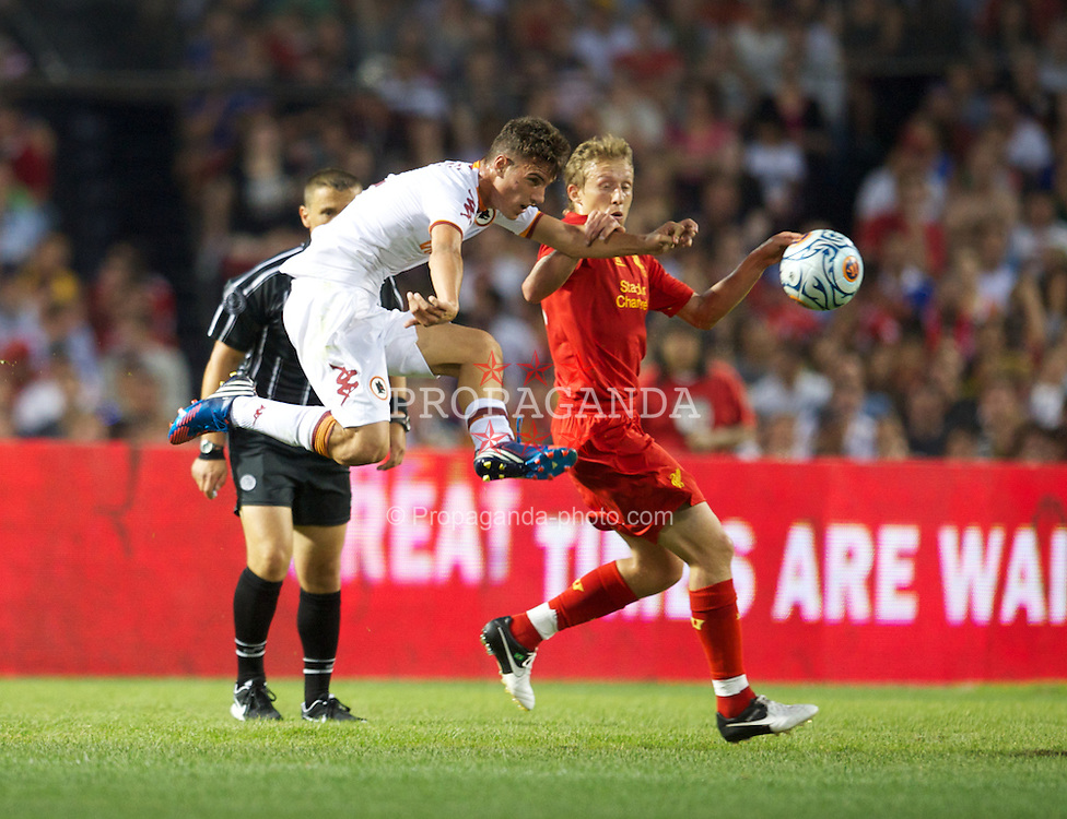 BOSTON, MA - Wednesday, July 25, 2012: Liverpool's Lucas Leiva in action against AS Roma's Leandro Castan da Silva during a pre-season friendly match at Fenway Park, home of the Boston Red Sox, the second match of the Reds' North American tour. (Pic by David Rawcliffe/Propaganda)