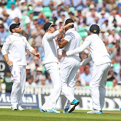 England's Chris Jordan and England players celebrate the wicket of India's Ajinkya Rahane for 0 during the first day of the Investec 5th Test match between England and India at the Kia Oval, London, 15th August 2014 © Phil Duncan | SportPix.org.uk