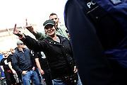 Frankfurt am Main | 20 Jun 2015<br /> <br /> Kundgebung der islamfeindlichen Gruppe &quot;Widerstand Ost West&quot; (WOW) um Ester Seitz, die Rechtspopulisten, rechte Hooligans und Neonazis vereint, auf dem Rossmarkt.<br /> Hier: Eine Demonstrantin zeigt einen Stinkefinger.<br /> <br /> Photo &copy; peter-juelich.com