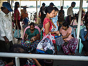 30 OCTOBER 2015 - YANGON, MYANMAR:  Passengers on the Dala Ferry. The ferry to Dala runs continuously through the day between Yangon and Dala. Yangon, Myanmar (Rangoon, Burma). Yangon, with a population of over five million, continues to be the country's largest city and the most important commercial center.          PHOTO BY JACK KURTZ