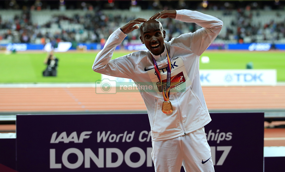 Great Britain's Mo Farah celebrates with his gold medal after winning the men's 10,000 metre final during day one of the 2017 IAAF World Championships at the London Stadium. PRESS ASSOCIATION Photo. Picture date: Friday August 4, 2017. See PA story ATHLETICS World. Photo credit should read: John Walton/PA Wire. RESTRICTIONS: Editorial use only. No transmission of sound or moving images and no video simulation.
