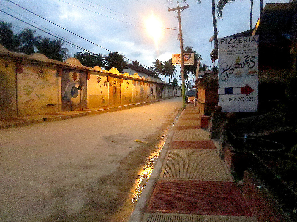 Early sunlight from main intersection, Las Terrenas. Wall lies between beach and main road.