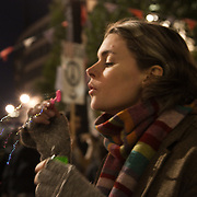 A women blowing bubbles in teh night. The London Stock Exchange was attempted occypied in solidarity with Occupy Wall in Street in New York and in protest againts the economic climate, blamed by many on the banks. Police managed to keep people away fro the Patornoster Sqaure and the Stcok Exchange and thousands of protestors stayid in St. Paul's Square, outside St Paul's Cathedral. Many camped getting ready to spend the night in the square.