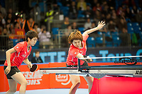 Yue GUO (CHN) and and Xiaoxia LI (CHN)  during the ITTF Table Tennis Tour Grand Finals, ExCel Centre,  London, England November 27, 2011. Guo and Li won the women's doubles title.