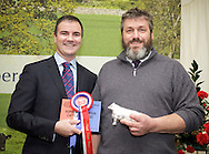 Scottish National Premier Meat Exhibition & competition to promote Scottish livestock from farm to consumer, sponsored by Marks & Spencer. Held at Scotbeef Ltd, Bridge of Allan, Saturday 19th Novermber, 2011...Malcolm Copland, head of trading at Marks & Spencer presents George McFadzean, Woodhead of Mailer, Perth - champ beef carcase.