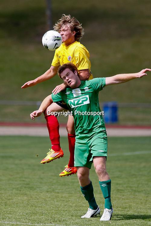 Jesse Edge jumps above Hamish McKay to contest the ball.  ASB Premiership football - Waikato FC v Youngheart Manawatu, Porritt Stadium, Hamilton, New Zealand.  Sunday 26 February 2012.  Photo: Bruce Lim / photosport.co.nz