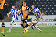 Fernando Forestieri of Sheffield Wednesday,Hull City midfielder Jake Livermore (14)  during the Sky Bet Championship match between Hull City and Sheffield Wednesday at the KC Stadium, Kingston upon Hull, England on 26 February 2016. Photo by Ian Lyall.
