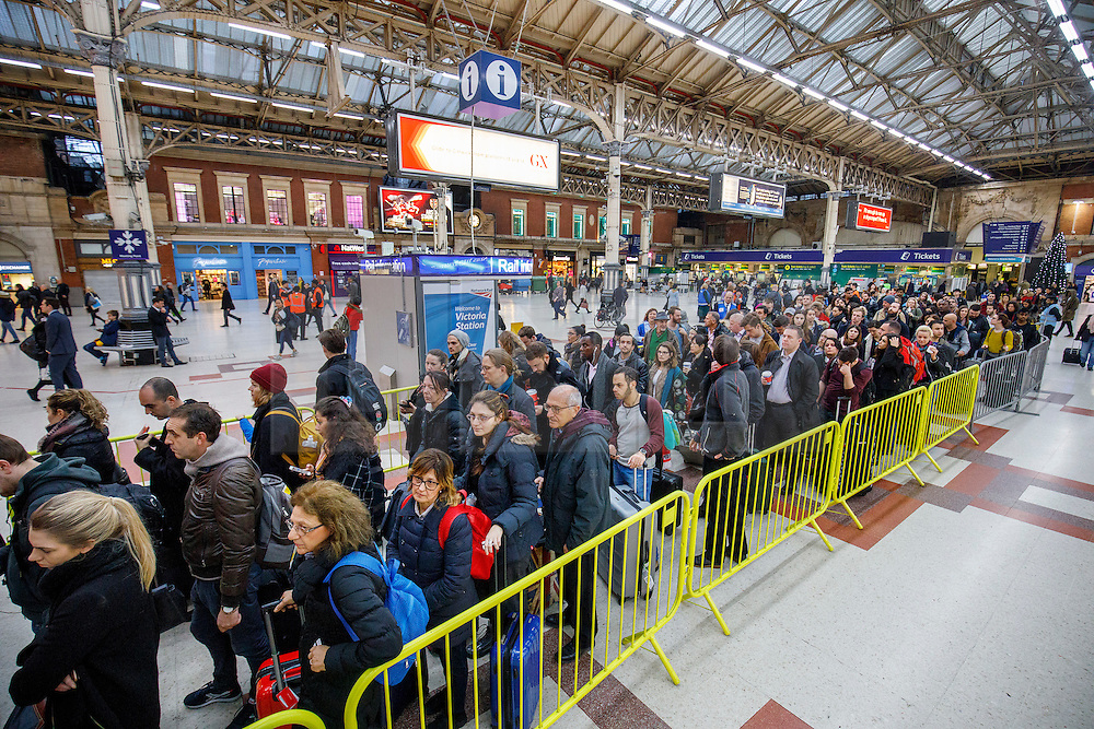 © Licensed to London News Pictures. 13/12/2016. London, UK. Commuters wait for a delayed service at Victoria Station in London on 13 December 2016, as hundreds of thousands of rail passengers face a 3 day all-out strike in an escalating dispute over the role of conductors between Southern Rail and the RMT Union. Photo credit: Tolga Akmen/LNP
