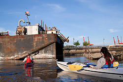 North America, United States, Washington, Seattle, Kayaking through industrial area of Duwamish Waterway near Port of Seattle
