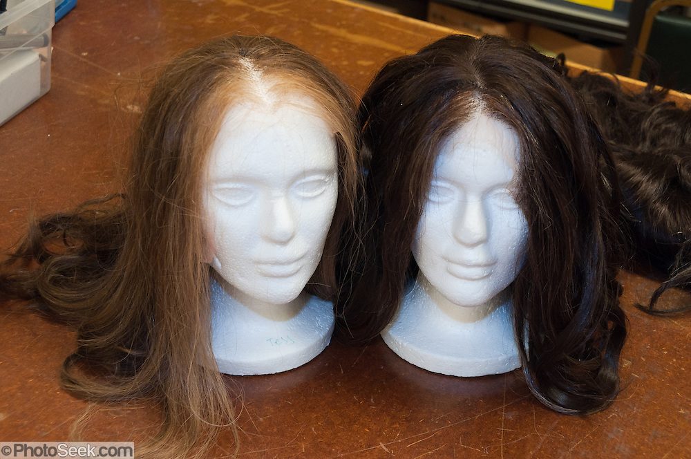 Blonde and brunette wigs on foam woman mannequin heads. University of Washington School of Drama, Seattle.