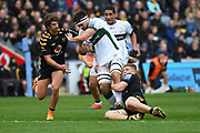 London Irish back row Matt Rogerson (6) is tackled by Wasps back row Jack Willis (7) during the Gallagher Premiership Rugby match between Wasps and London Irish at the Ricoh Arena, Coventry, England on 20 October 2019.