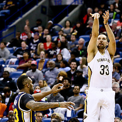 Feb 10, 2016; New Orleans, LA, USA; New Orleans Pelicans forward Ryan Anderson (33) shoots over Utah Jazz forward Trevor Booker (33) during the second quarter of a game at the Smoothie King Center. Mandatory Credit: Derick E. Hingle-USA TODAY Sports