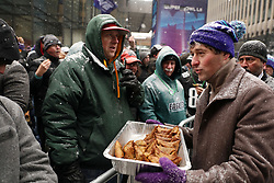 February 3, 2018 - Minneapolis, MN, USA - Minneapolis mayor Jacob Frey hands out sambusa, a fried Somali dish with a savory filling from the restaurant Afro Deli, to Philadelphia Eagles fans during their rally on Saturday, Feb. 3, 2018, as part of Super Bowl Live in downtown Minneapolis. (Credit Image: © Anthony Souffle/TNS via ZUMA Wire)