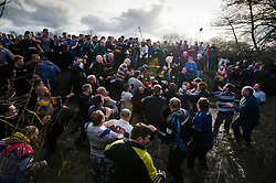 © London News Pictures. 04/03/2014. Ashbourne, UK. Two teams, the Up'Ards and the Down'Ards, fight for the ball during the first day of the Royal Shrovetide Football match in Ashbourne, Derbyshire. For two days, over Shrove Tuesday and Ash Wednesday, hundreds of participants battle it out in a 'no rules' game dating back to the 17th Century where the aim is to get a ball into one of two goals that are positioned three miles apart at either end of Ashboune. Photo credit: Ben Cawthra/LNP