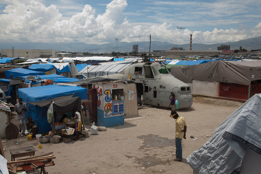 Daily life in the makeshift refugee camp, La Piste, in Port-au-Prince, Haiti on July 22, 2010. La Piste (French for &quot;runway&quot;)is a settlement sprawled across the site of a disused airport and now home to an estimated 20,000 earthquake survivors living in makeshift structures.<br /> Six month after a catastrophic earthquake measuring 7.3 on the Richter scale hit Haiti on January 13, 2010, killing an estimated 230,000 people, injuring an estimated 300,000 and making homeless an estimated 1,000,000.