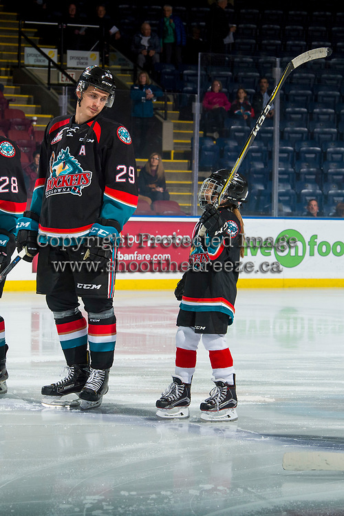 KELOWNA, BC - OCTOBER 03:   The seventh player of the game raises her stick alongside Nolan Foote #29 of the Kelowna Rockets as they line up against the Vancouver Giants at Prospera Place on October 3, 2018 in Kelowna, Canada. (Photo by Marissa Baecker/Getty Images)