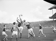 Player jumps at ball during the All Ireland Minor Gaelic Football Final Cork v. Mayo in Croke Park on the 24th September 1961.