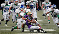 25 Nov. 201 -- ST. LOUIS -- Blue Springs South High School punt coverage players, including Cameron Clim (3), tackle CBC High School kick returner Justin Allen (80) during the second half of the MSHSAA Class 6 state championship Friday, Nov. 25, 2011 at the Edward Jones Dome in St. Louis. Photo © copyright 2011 Sid Hastings.