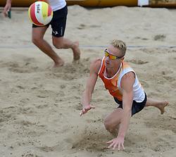16-08-2014 NED: NK Beachvolleybal 2014, Scheveningen<br /> Sven Vismans (1)