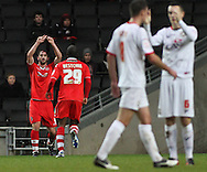 Picture by David Horn/Focus Images Ltd +44 7545 970036.26/12/2012.Will Grigg of Walsall celebrates scoring with team make Craig Westcarr during the npower League 1 match at stadium:mk, Milton Keynes.
