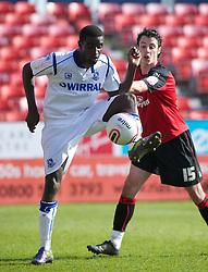 BOURNEMOUTH, ENGLAND - Saturday, April 9, 2011: Tranmere Rovers' Zoumana Bakayogo and Bournemouth's Adam Smith in action during the Football League One match at the Dean Court Stadium. (Photo by Gareth Davies/Propaganda)