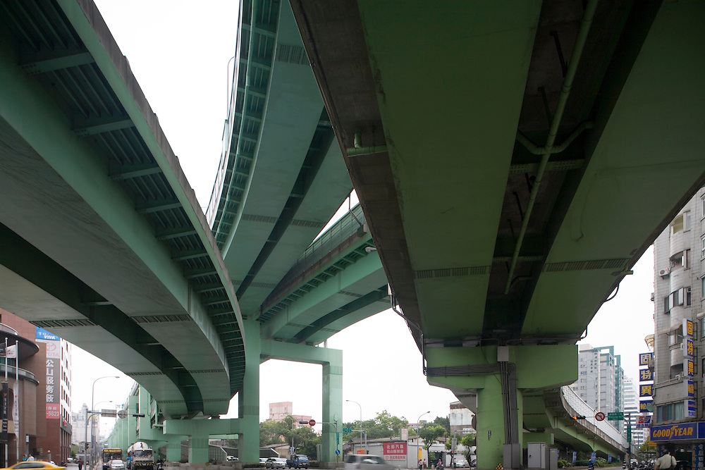Taiwan, Taipei, View from underneath highway overpasses intersecting over downtown city streets