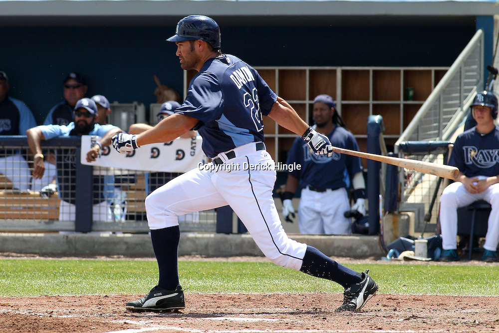 March 15, 2011; Port Charlotte, FL, USA; Tampa Bay Rays left fielder Johnny Damon (22) at bat during a spring training exhibition game against the Florida Marlins at Charlotte Sports Park.   Mandatory Credit: Derick E. Hingle