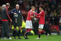 MANCHESTER, ENGLAND - Tuesday, October 26, 2010: Manchester United's Ravel Morrison replaces Ji-Sung Park during the Football League Cup 4th Round match against Wolverhampton Wanderers at Old Trafford. (Pic by: David Rawcliffe/Propaganda)