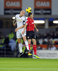 Swansea City's Jonjo Shelvey battles for the high ball with Cardiff City's Jordon Mutch - Photo mandatory by-line: Joe Meredith/JMP - Tel: Mobile: 07966 386802 03/11/2013 - SPORT - FOOTBALL - The Cardiff City Stadium - Cardiff - Cardiff City v Swansea City - Barclays Premier League