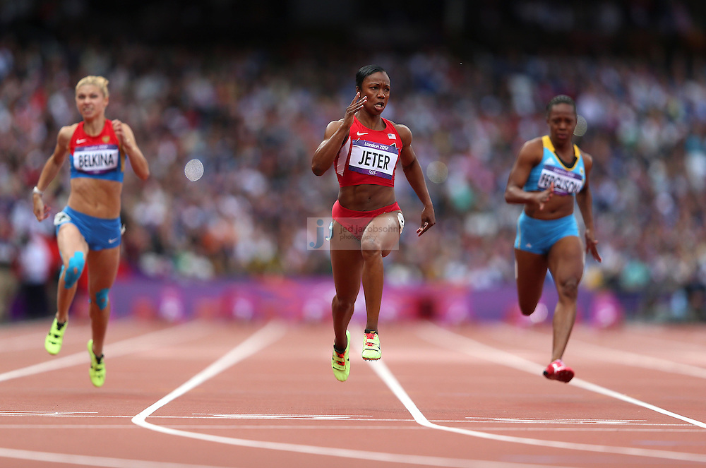 Carmelita Jeter runs in a 100m heat during the track and field at the Olympic Stadium during day 6 of the London Olympic Games in London, England, United Kingdom on August 3, 2012..(Jed Jacobsohn/for The New York Times)..