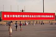 A electronic sign flashes slogans in Tian'an Men square in Beijing, China