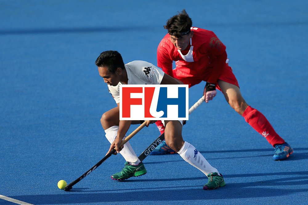 LONDON, ENGLAND - JUNE 20: Talake Du of China put pressure on Haziq Samsul of Malaysia during the Pool A match between China and Malaysia on day six of the Hero Hockey World League Semi-Final at Lee Valley Hockey and Tennis Centre on June 20, 2017 in London, England.  (Photo by Alex Morton/Getty Images)