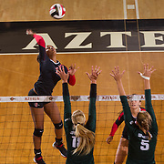 27 August 2016: The San Diego State Aztecs took on the Michigan State Spartans in game two of the Aztec Invitational at Peterson Gym on the campus of SDSU. OH Ashlynn Dunbar (6) spikes the ball in the first set against the Spartan defense. The Aztecs lost 3-1 to the Spartans. www.sdsuaztecphotos.com