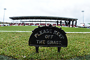 Keep of the Grass sign on the pitch during the EFL Sky Bet League 2 match between Northampton Town and Grimsby Town FC at Sixfields Stadium, Northampton, England on 24 November 2018.