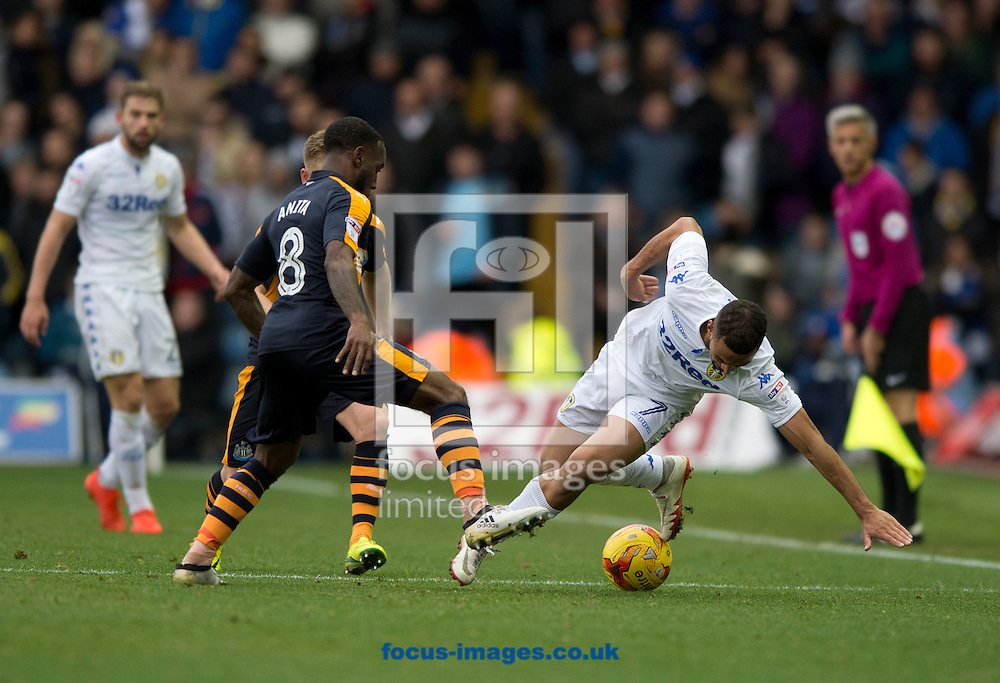 Kemar Roofe of Leeds United (right) turns outside Vurnon Anita of Newcastle United during the Sky Bet Championship match at Elland Road, Leeds<br /> Picture by Russell Hart/Focus Images Ltd 07791 688 420<br /> 20/11/2016