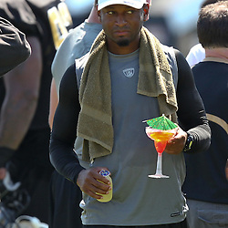 July 31, 2011; Metairie, LA, USA; New Orleans Saints cornerback Leigh Torrence holds a Shirley Temple drink after coach Sean Payton handed out the drinks to veterans who are unable to practice during training camp practice at the New Orleans Saints practice facility. Mandatory Credit: Derick E. Hingle