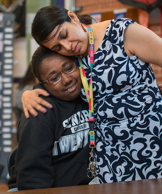 College Access Coordinator Alpa Sridharan, right, hugs a student on National FAFSA Day at Davis High School, February 20, 2014.