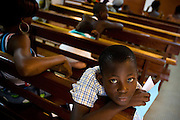 Kwasi Yao Lionel, 12, sits in the waiting room of the NDA health center in Dimbokro, Cote d'Ivoire on Friday June 19, 2009.