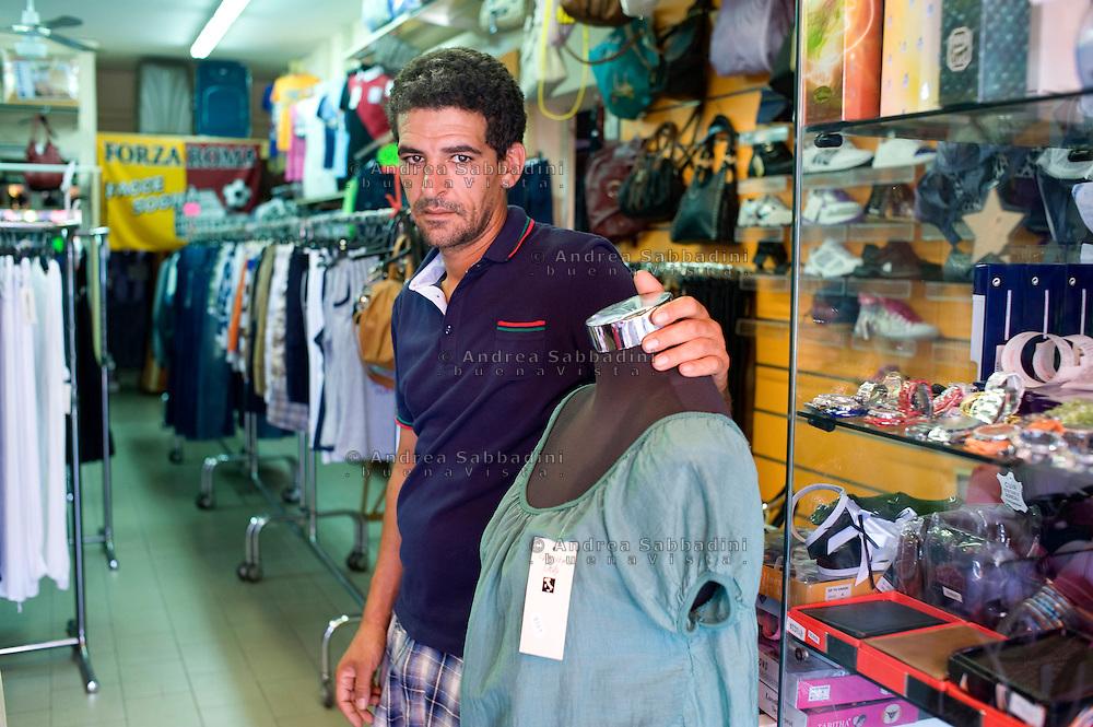 Lavinio (Roma), 16/08/2011: Omar, originario di Fes in Marocco, lavora come commesso in un negozio di abbigliamento.©Andrea Sabbadini