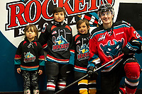 KELOWNA, CANADA - NOVEMBER 21:  Kyle Crosbie #25 of the Kelowna Rockets poses with young fans after warm up against the Regina Pats on November 21, 2018 at Prospera Place in Kelowna, British Columbia, Canada.  (Photo by Marissa Baecker/Shoot the Breeze)